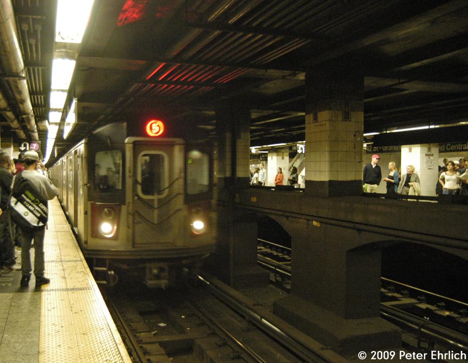 (249k, 930x723)<br><b>Country:</b> United States<br><b>City:</b> New York<br><b>System:</b> New York City Transit<br><b>Line:</b> IRT East Side Line<br><b>Location:</b> Grand Central <br><b>Route:</b> 5<br><b>Car:</b> R-142 (Primary Order, Bombardier, 1999-2002)  6771 <br><b>Photo by:</b> Peter Ehrlich<br><b>Date:</b> 10/9/2009<br><b>Viewed (this week/total):</b> 2 / 1385