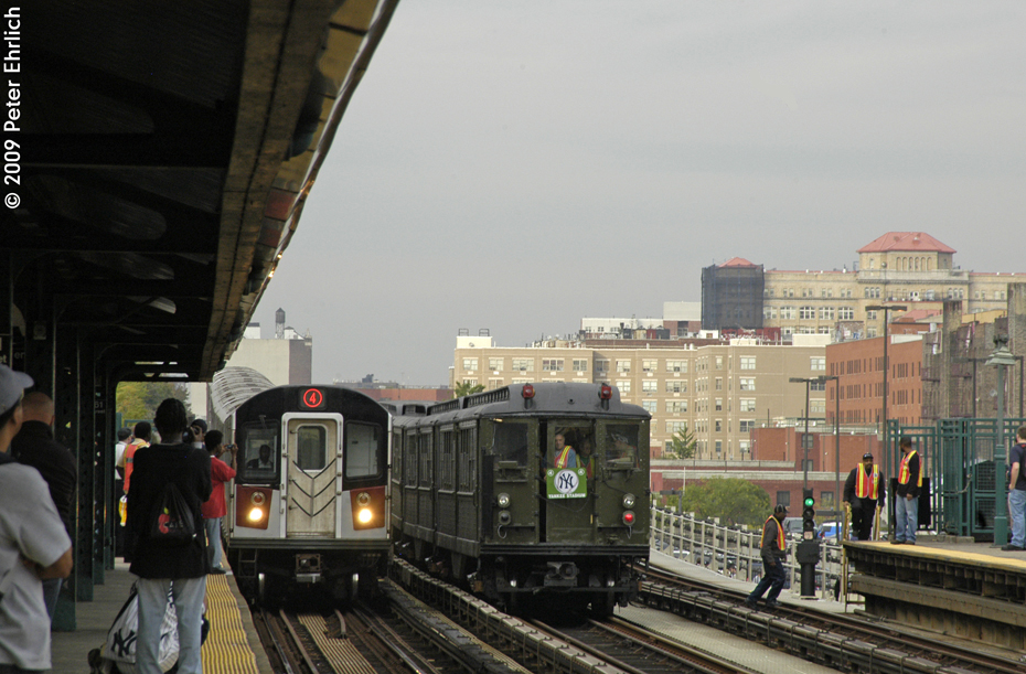(522k, 930x611)<br><b>Country:</b> United States<br><b>City:</b> New York<br><b>System:</b> New York City Transit<br><b>Line:</b> IRT Woodlawn Line<br><b>Location:</b> 161st Street/River Avenue (Yankee Stadium) <br><b>Route:</b> Fan Trip<br><b>Car:</b> Low-V (Museum Train) 5292 <br><b>Photo by:</b> Peter Ehrlich<br><b>Date:</b> 10/9/2009<br><b>Notes:</b> Yankee Stadium Special-- With R152 7766 approaching/arriving inbound.<br><b>Viewed (this week/total):</b> 0 / 1002