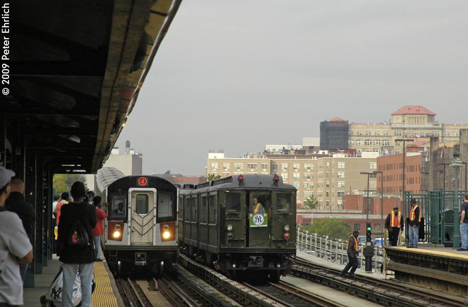 (522k, 930x611)<br><b>Country:</b> United States<br><b>City:</b> New York<br><b>System:</b> New York City Transit<br><b>Line:</b> IRT Woodlawn Line<br><b>Location:</b> 161st Street/River Avenue (Yankee Stadium) <br><b>Route:</b> Fan Trip<br><b>Car:</b> Low-V (Museum Train) 5292 <br><b>Photo by:</b> Peter Ehrlich<br><b>Date:</b> 10/9/2009<br><b>Notes:</b> Yankee Stadium Special-- With R152 7766 approaching/arriving inbound.<br><b>Viewed (this week/total):</b> 0 / 991