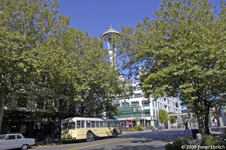 (383k, 930x618)<br><b>Country:</b> United States<br><b>City:</b> Seattle, WA<br><b>System:</b> King Country Metro<br><b>Car:</b> Seattle Trolley Coach 1005 <br><b>Photo by:</b> Peter Ehrlich<br><b>Date:</b> 9/11/2009<br><b>Notes:</b> 5th Avenue/Denny Way, inbound.  The Space Needle is in the background.<br><b>Viewed (this week/total):</b> 2 / 1396
