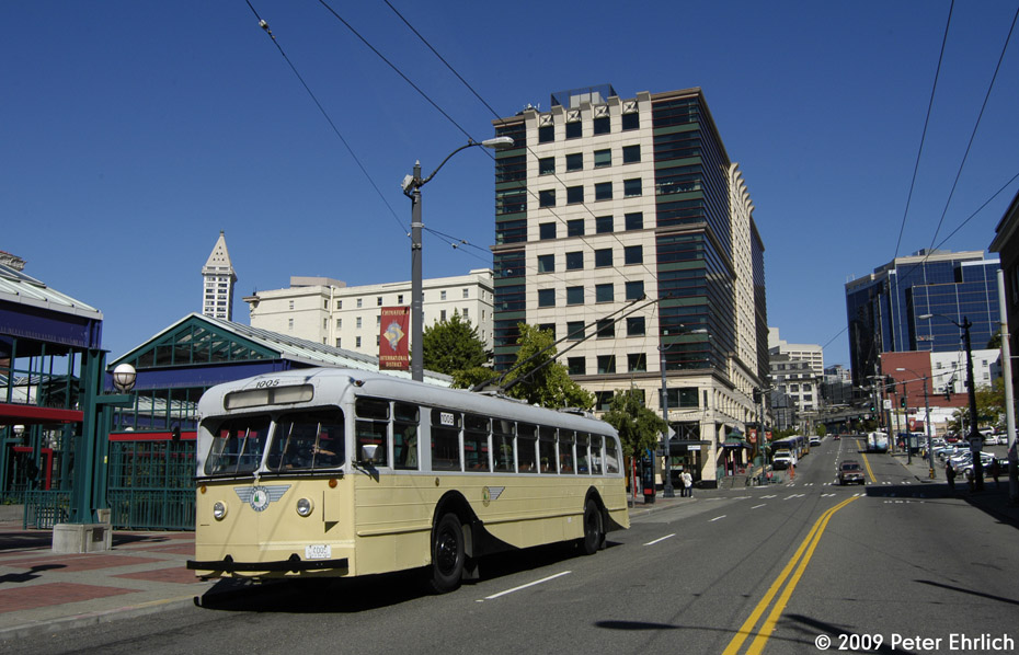 (202k, 930x598)<br><b>Country:</b> United States<br><b>City:</b> Seattle, WA<br><b>System:</b> King Country Metro<br><b>Car:</b> Seattle Trolley Coach 1005 <br><b>Photo by:</b> Peter Ehrlich<br><b>Date:</b> 9/11/2009<br><b>Notes:</b> International District Station, south of S. Jackson Street.  The Smith Tower and other downtown Seattle highrises are in the background.  Also in the background:  the inner terminal station of the currently-suspended Waterfront Streetcar.<br><b>Viewed (this week/total):</b> 0 / 1511