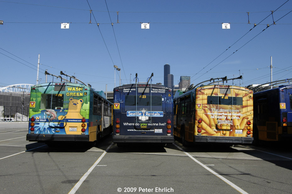 (190k, 930x618)<br><b>Country:</b> United States<br><b>City:</b> Seattle, WA<br><b>System:</b> King Country Metro<br><b>Car:</b> Seattle Gillig Trolley Coach 4116 <br><b>Photo by:</b> Peter Ehrlich<br><b>Date:</b> 9/11/2009<br><b>Notes:</b> Rear ends of coaches 4116, 4123 and 4188 with adverts, at Atlantic Base.<br><b>Viewed (this week/total):</b> 1 / 1503