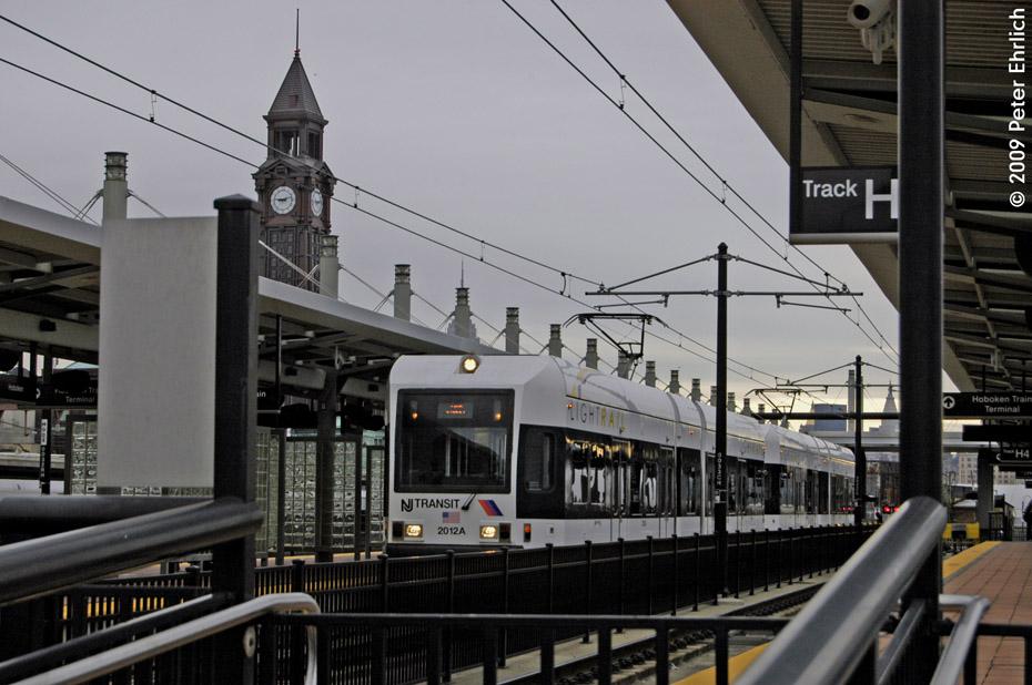 (194k, 930x618)<br><b>Country:</b> United States<br><b>City:</b> Hoboken, NJ<br><b>System:</b> Hudson Bergen Light Rail<br><b>Location:</b> Hoboken <br><b>Car:</b> NJT-HBLR LRV (Kinki-Sharyo, 1998-99)  2012 <br><b>Photo by:</b> Peter Ehrlich<br><b>Date:</b> 10/9/2009<br><b>Viewed (this week/total):</b> 1 / 342