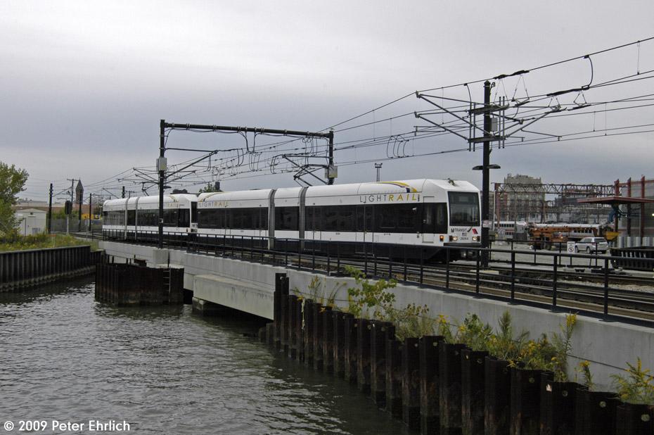 (196k, 930x618)<br><b>Country:</b> United States<br><b>City:</b> Hoboken, NJ<br><b>System:</b> Hudson Bergen Light Rail<br><b>Location:</b> Hoboken <br><b>Car:</b> NJT-HBLR LRV (Kinki-Sharyo, 1998-99)  2026 <br><b>Photo by:</b> Peter Ehrlich<br><b>Date:</b> 10/9/2009<br><b>Viewed (this week/total):</b> 1 / 365