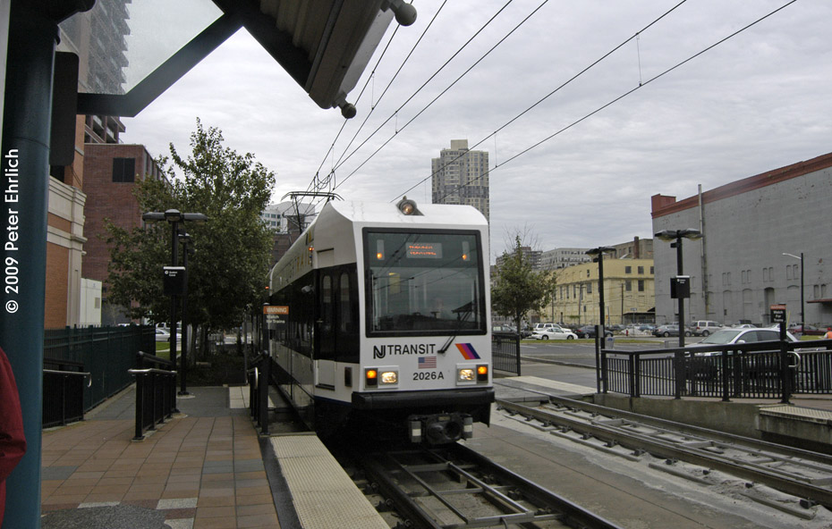 (197k, 930x592)<br><b>Country:</b> United States<br><b>City:</b> Jersey City, NJ<br><b>System:</b> Hudson Bergen Light Rail<br><b>Location:</b> Harsimus Cove <br><b>Car:</b> NJT-HBLR LRV (Kinki-Sharyo, 1998-99)  2026 <br><b>Photo by:</b> Peter Ehrlich<br><b>Date:</b> 10/9/2009<br><b>Notes:</b> Inbound.<br><b>Viewed (this week/total):</b> 0 / 353