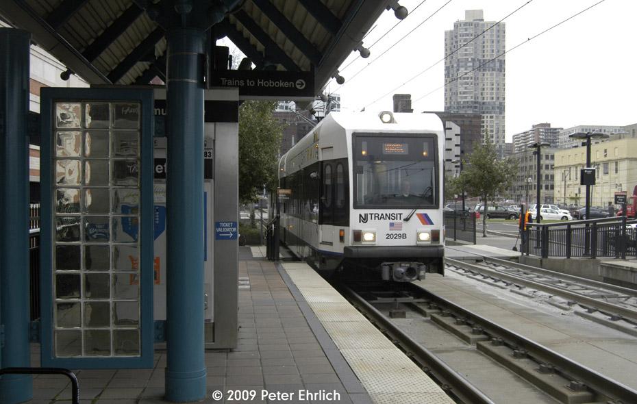 (189k, 930x590)<br><b>Country:</b> United States<br><b>City:</b> Jersey City, NJ<br><b>System:</b> Hudson Bergen Light Rail<br><b>Location:</b> Harsimus Cove <br><b>Car:</b> NJT-HBLR LRV (Kinki-Sharyo, 1998-99)  2029 <br><b>Photo by:</b> Peter Ehrlich<br><b>Date:</b> 10/9/2009<br><b>Notes:</b> Inbound.<br><b>Viewed (this week/total):</b> 1 / 441