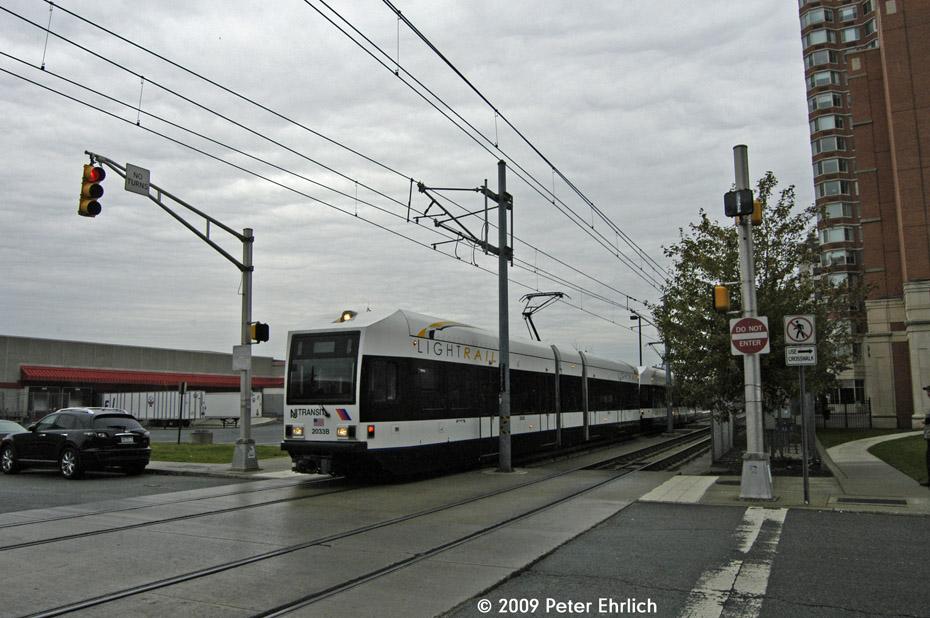(203k, 930x618)<br><b>Country:</b> United States<br><b>City:</b> Jersey City, NJ<br><b>System:</b> Hudson Bergen Light Rail<br><b>Location:</b> Harsimus Cove <br><b>Car:</b> NJT-HBLR LRV (Kinki-Sharyo, 1998-99)  2033 <br><b>Photo by:</b> Peter Ehrlich<br><b>Date:</b> 10/9/2009<br><b>Notes:</b> Outbound.<br><b>Viewed (this week/total):</b> 0 / 366