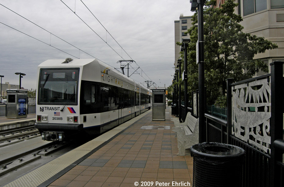 (201k, 930x613)<br><b>Country:</b> United States<br><b>City:</b> Jersey City, NJ<br><b>System:</b> Hudson Bergen Light Rail<br><b>Location:</b> Harsimus Cove <br><b>Car:</b> NJT-HBLR LRV (Kinki-Sharyo, 1998-99)  2038 <br><b>Photo by:</b> Peter Ehrlich<br><b>Date:</b> 10/9/2009<br><b>Notes:</b> Inbound.<br><b>Viewed (this week/total):</b> 0 / 346