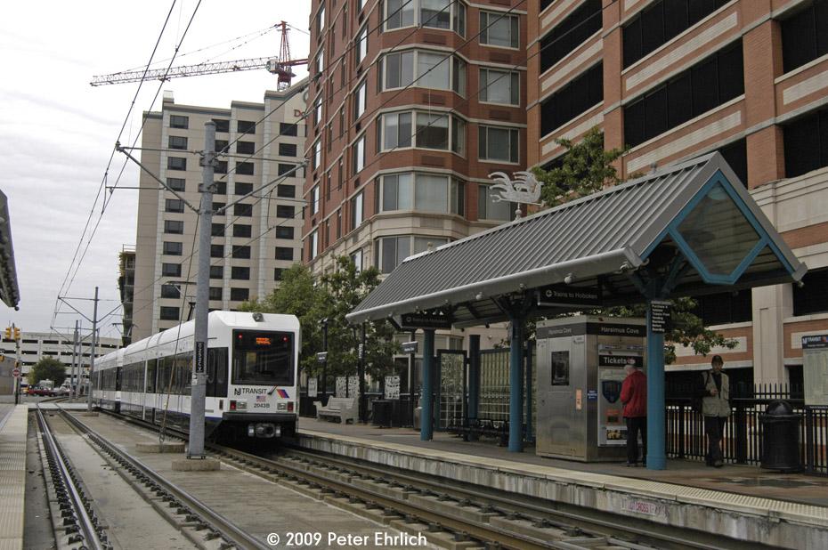 (242k, 930x618)<br><b>Country:</b> United States<br><b>City:</b> Jersey City, NJ<br><b>System:</b> Hudson Bergen Light Rail<br><b>Location:</b> Harsimus Cove <br><b>Car:</b> NJT-HBLR LRV (Kinki-Sharyo, 1998-99)  2043 <br><b>Photo by:</b> Peter Ehrlich<br><b>Date:</b> 10/9/2009<br><b>Notes:</b> Inbound.<br><b>Viewed (this week/total):</b> 0 / 391