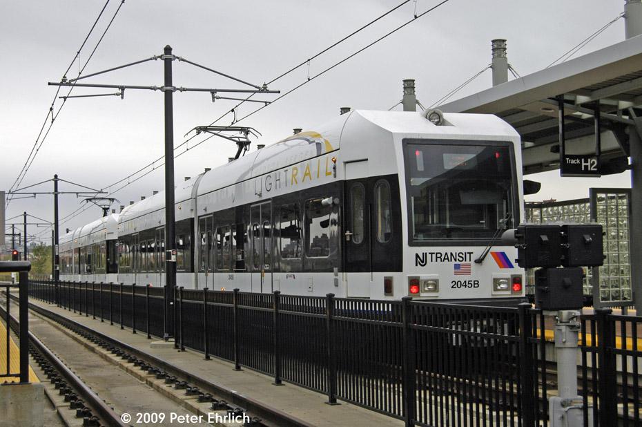 (209k, 930x618)<br><b>Country:</b> United States<br><b>City:</b> Hoboken, NJ<br><b>System:</b> Hudson Bergen Light Rail<br><b>Location:</b> Hoboken <br><b>Car:</b> NJT-HBLR LRV (Kinki-Sharyo, 1998-99)  2045 <br><b>Photo by:</b> Peter Ehrlich<br><b>Date:</b> 10/9/2009<br><b>Viewed (this week/total):</b> 0 / 440