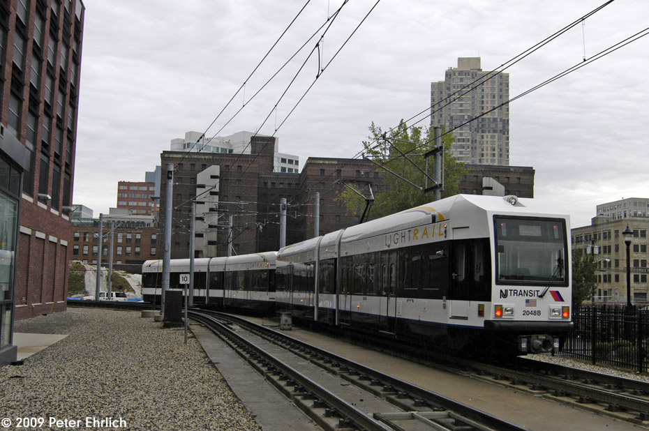 (220k, 930x618)<br><b>Country:</b> United States<br><b>City:</b> Jersey City, NJ<br><b>System:</b> Hudson Bergen Light Rail<br><b>Location:</b> Harsimus Cove <br><b>Car:</b> NJT-HBLR LRV (Kinki-Sharyo, 1998-99)  2048 <br><b>Photo by:</b> Peter Ehrlich<br><b>Date:</b> 10/9/2009<br><b>Notes:</b> Outbound.<br><b>Viewed (this week/total):</b> 0 / 390