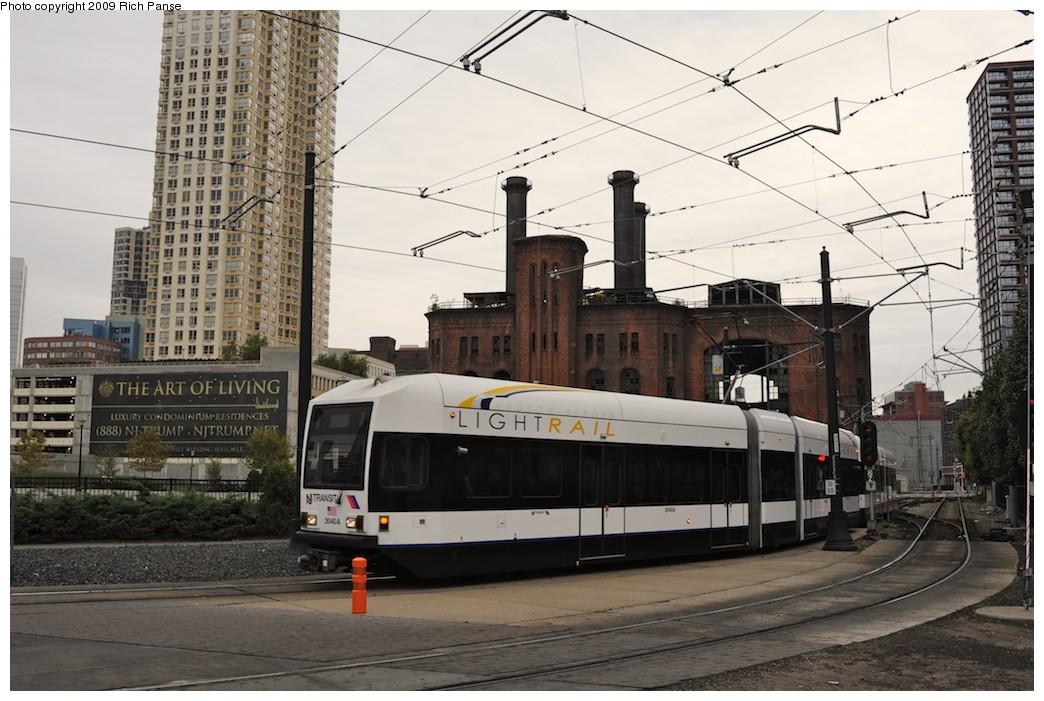 (194k, 1044x701)<br><b>Country:</b> United States<br><b>City:</b> Jersey City, NJ<br><b>System:</b> Hudson Bergen Light Rail<br><b>Location:</b> Harborside <br><b>Car:</b> NJT-HBLR LRV (Kinki-Sharyo, 1998-99)  2040 <br><b>Photo by:</b> Richard Panse<br><b>Date:</b> 10/9/2009<br><b>Viewed (this week/total):</b> 0 / 373