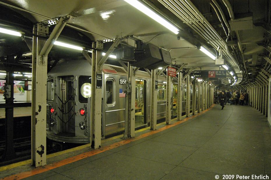 (225k, 930x618)<br><b>Country:</b> United States<br><b>City:</b> New York<br><b>System:</b> New York City Transit<br><b>Line:</b> IRT Times Square-Grand Central Shuttle<br><b>Location:</b> Times Square <br><b>Route:</b> S<br><b>Car:</b> R-62A (Bombardier, 1984-1987)  1956 <br><b>Photo by:</b> Peter Ehrlich<br><b>Date:</b> 10/30/2009<br><b>Viewed (this week/total):</b> 0 / 1464