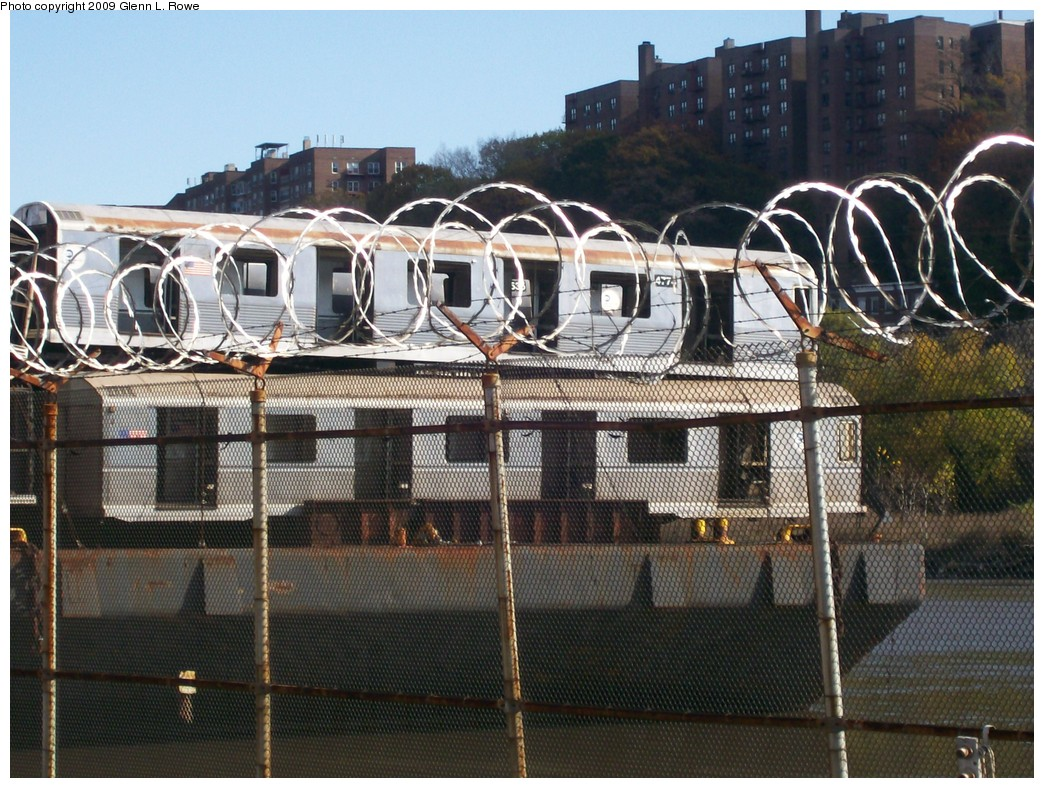 (267k, 1044x788)<br><b>Country:</b> United States<br><b>City:</b> New York<br><b>System:</b> New York City Transit<br><b>Location:</b> 207th Street Yard<br><b>Car:</b> R-42 (St. Louis, 1969-1970)  4774 <br><b>Photo by:</b> Glenn L. Rowe<br><b>Date:</b> 11/6/2009<br><b>Notes:</b> Barge-Scrapping<br><b>Viewed (this week/total):</b> 0 / 762