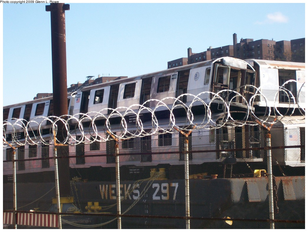 (248k, 1044x788)<br><b>Country:</b> United States<br><b>City:</b> New York<br><b>System:</b> New York City Transit<br><b>Location:</b> 207th Street Yard<br><b>Car:</b> R-42 (St. Louis, 1969-1970)  4653 <br><b>Photo by:</b> Glenn L. Rowe<br><b>Date:</b> 11/6/2009<br><b>Notes:</b> Barge-Scrapping<br><b>Viewed (this week/total):</b> 0 / 986