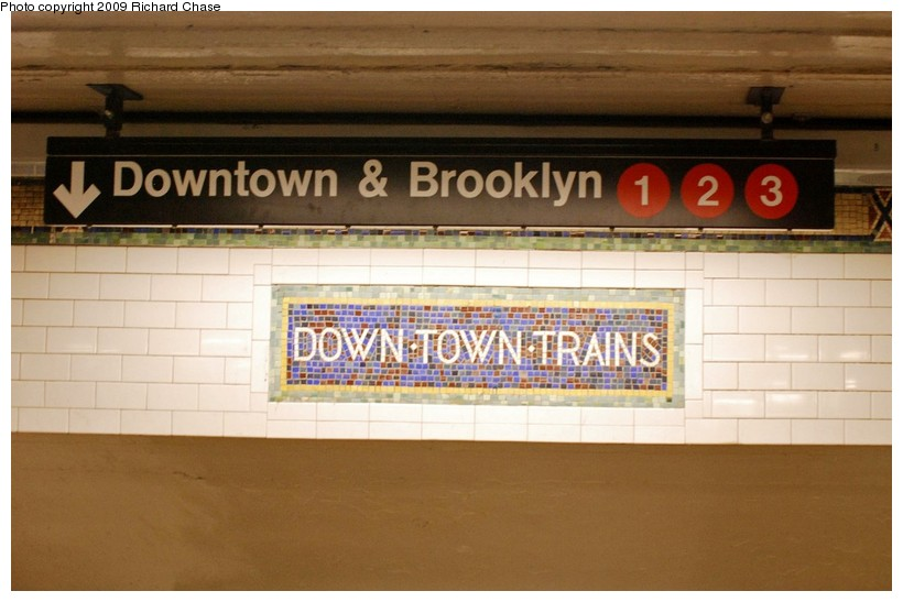 (101k, 820x547)<br><b>Country:</b> United States<br><b>City:</b> New York<br><b>System:</b> New York City Transit<br><b>Line:</b> IRT West Side Line<br><b>Location:</b> 34th Street/Penn Station <br><b>Photo by:</b> Richard Chase<br><b>Date:</b> 10/28/2009<br><b>Notes:</b> Downtown mosaic and signage.<br><b>Viewed (this week/total):</b> 0 / 907