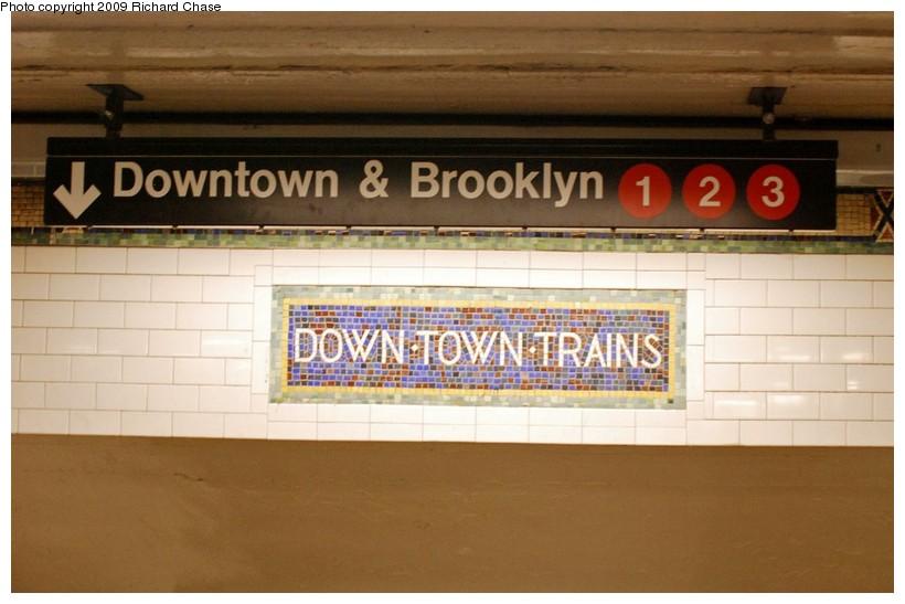 (101k, 820x547)<br><b>Country:</b> United States<br><b>City:</b> New York<br><b>System:</b> New York City Transit<br><b>Line:</b> IRT West Side Line<br><b>Location:</b> 34th Street/Penn Station <br><b>Photo by:</b> Richard Chase<br><b>Date:</b> 10/28/2009<br><b>Notes:</b> Downtown mosaic and signage.<br><b>Viewed (this week/total):</b> 2 / 923