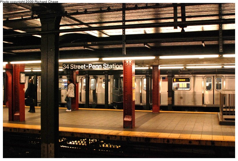 (148k, 820x555)<br><b>Country:</b> United States<br><b>City:</b> New York<br><b>System:</b> New York City Transit<br><b>Line:</b> IND 8th Avenue Line<br><b>Location:</b> 34th Street/Penn Station <br><b>Route:</b> E<br><b>Car:</b> R-160A/R-160B Series (Number Unknown)  <br><b>Photo by:</b> Richard Chase<br><b>Date:</b> 10/12/2009<br><b>Viewed (this week/total):</b> 1 / 2163