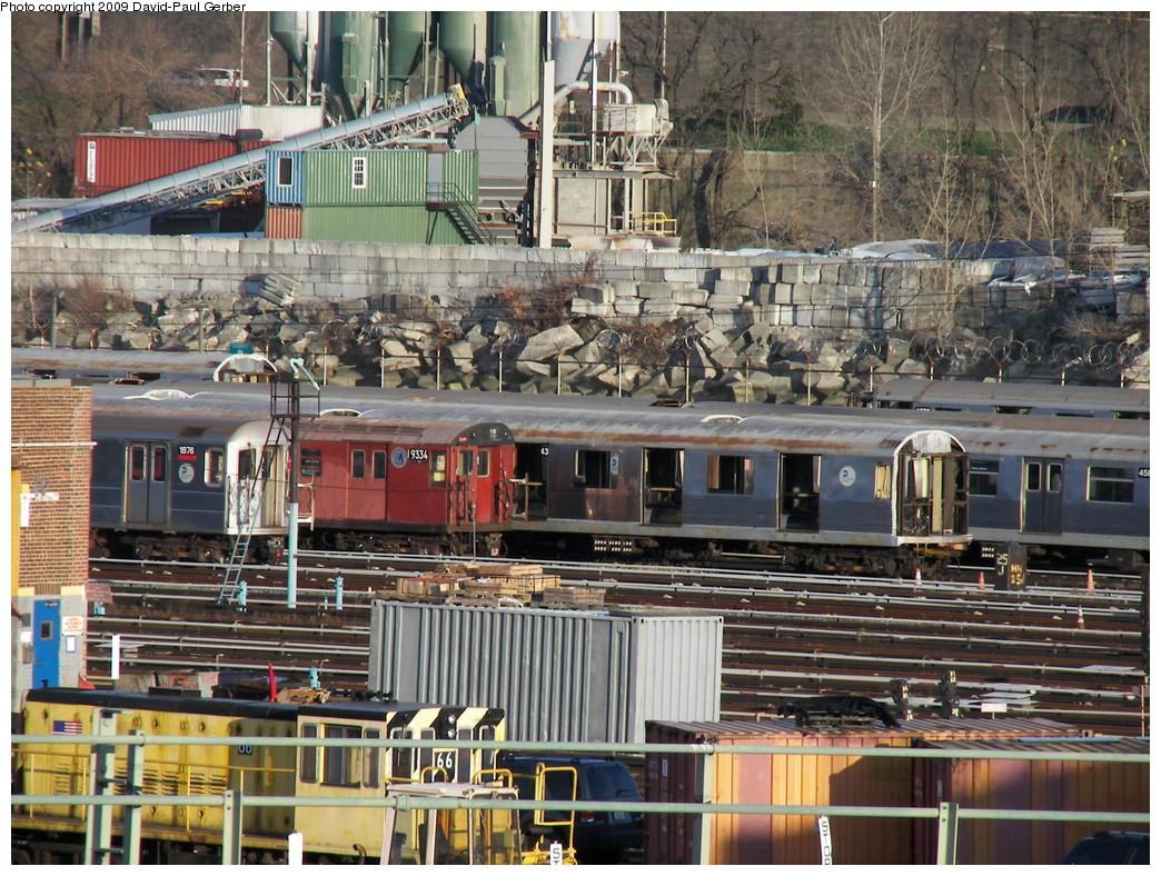 (367k, 1044x788)<br><b>Country:</b> United States<br><b>City:</b> New York<br><b>System:</b> New York City Transit<br><b>Location:</b> 207th Street Yard<br><b>Photo by:</b> David-Paul Gerber<br><b>Date:</b> 11/28/2009<br><b>Notes:</b> Visible are R33-WF 9334, R62 1876, R42s being scrapped.<br><b>Viewed (this week/total):</b> 0 / 612