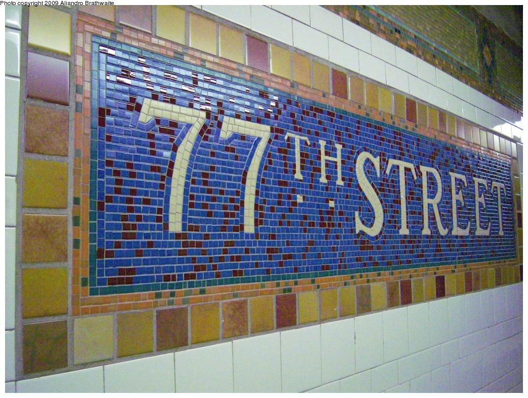 (321k, 1044x788)<br><b>Country:</b> United States<br><b>City:</b> New York<br><b>System:</b> New York City Transit<br><b>Line:</b> IRT East Side Line<br><b>Location:</b> 77th Street <br><b>Photo by:</b> Aliandro Brathwaite<br><b>Date:</b> 8/31/2009<br><b>Notes:</b> Mosaic name tile closeup<br><b>Viewed (this week/total):</b> 0 / 878