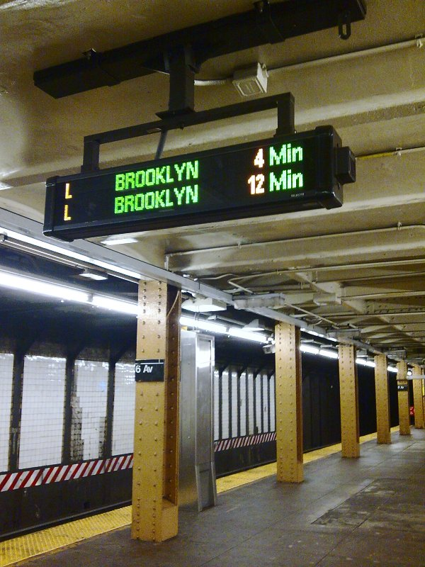 (121k, 600x800)<br><b>Country:</b> United States<br><b>City:</b> New York<br><b>System:</b> New York City Transit<br><b>Line:</b> BMT Canarsie Line<br><b>Location:</b> 6th Avenue <br><b>Photo by:</b> Bill E.<br><b>Date:</b> 10/31/2009<br><b>Notes:</b> Train arrival board<br><b>Viewed (this week/total):</b> 1 / 1098