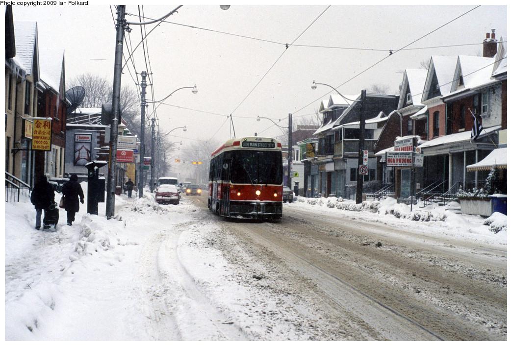 (282k, 1044x706)<br><b>Country:</b> Canada<br><b>City:</b> Toronto<br><b>System:</b> TTC<br><b>Line:</b> TTC 506-Carlton<br><b>Location:</b> Gerrard/Howland<br><b>Car:</b> TTC CLRV 4156 <br><b>Photo by:</b> Ian Folkard<br><b>Date:</b> 1/28/2009<br><b>Notes:</b> On the nearest utility pole, seen edge-on, is a red-and-yellow Sunday stop for the Metropolitan Community Church of Toronto.  <br><b>Viewed (this week/total):</b> 0 / 549