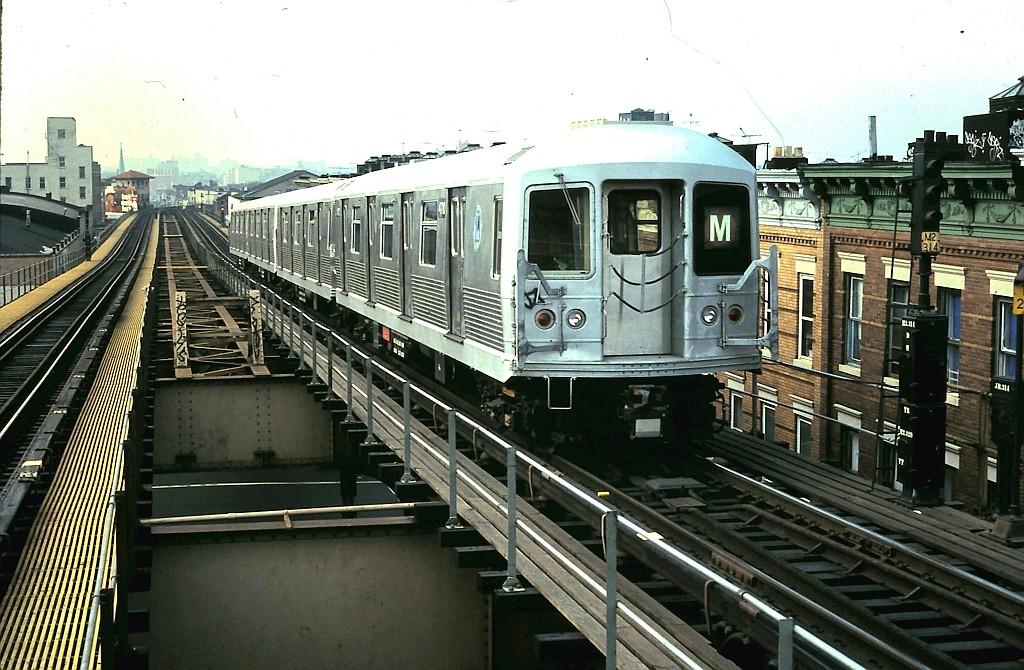 (218k, 1024x670)<br><b>Country:</b> United States<br><b>City:</b> New York<br><b>System:</b> New York City Transit<br><b>Line:</b> BMT Myrtle Avenue Line<br><b>Location:</b> Seneca Avenue <br><b>Route:</b> M<br><b>Car:</b> R-42 (St. Louis, 1969-1970)  4710 <br><b>Collection of:</b> John Barnes<br><b>Date:</b> 10/16/1988<br><b>Viewed (this week/total):</b> 4 / 2350