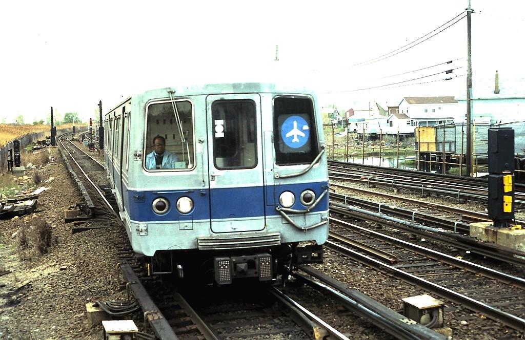 (219k, 1024x664)<br><b>Country:</b> United States<br><b>City:</b> New York<br><b>System:</b> New York City Transit<br><b>Line:</b> IND Rockaway<br><b>Location:</b> Howard Beach <br><b>Route:</b> JFK<br><b>Car:</b> R-46 (Pullman-Standard, 1974-75)  <br><b>Collection of:</b> John Barnes<br><b>Date:</b> 5/2/1987<br><b>Viewed (this week/total):</b> 4 / 2925