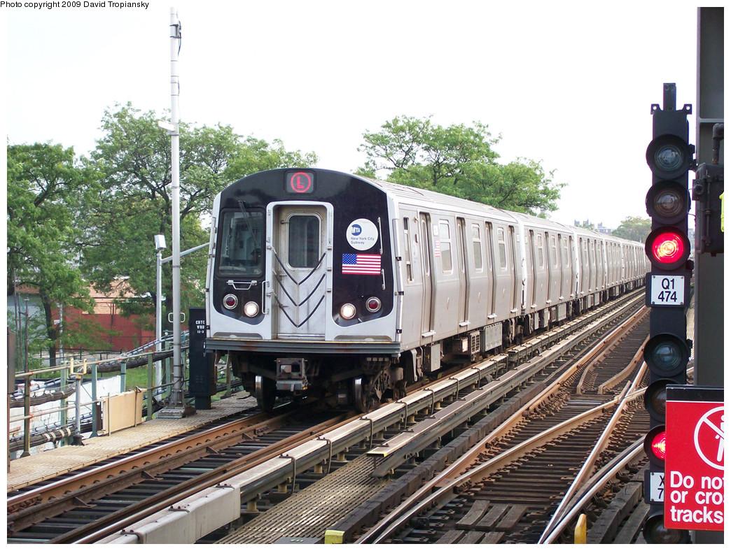 (348k, 1044x788)<br><b>Country:</b> United States<br><b>City:</b> New York<br><b>System:</b> New York City Transit<br><b>Line:</b> BMT Canarsie Line<br><b>Location:</b> Livonia Avenue <br><b>Route:</b> L<br><b>Car:</b> R-143 (Kawasaki, 2001-2002) 8293 <br><b>Photo by:</b> David Tropiansky<br><b>Date:</b> 8/25/2008<br><b>Viewed (this week/total):</b> 1 / 1138