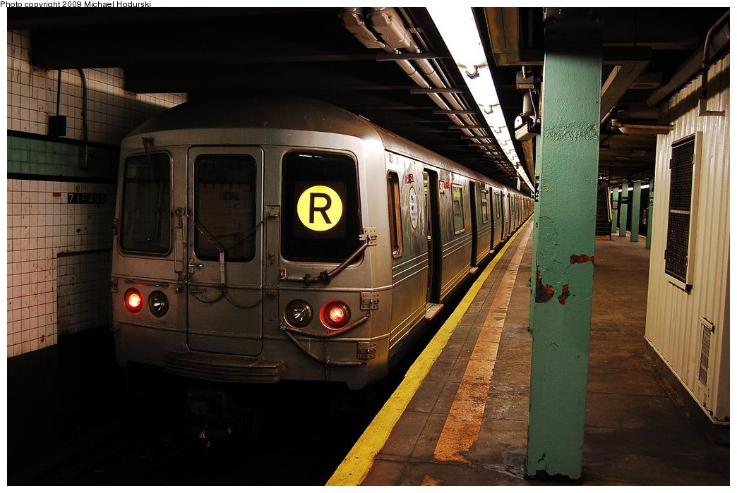 (219k, 1044x699)<br><b>Country:</b> United States<br><b>City:</b> New York<br><b>System:</b> New York City Transit<br><b>Line:</b> IND Queens Boulevard Line<br><b>Location:</b> 71st/Continental Aves./Forest Hills <br><b>Route:</b> R<br><b>Car:</b> R-46 (Pullman-Standard, 1974-75) 5974 <br><b>Photo by:</b> Michael Hodurski<br><b>Date:</b> 12/10/2009<br><b>Viewed (this week/total):</b> 3 / 1130
