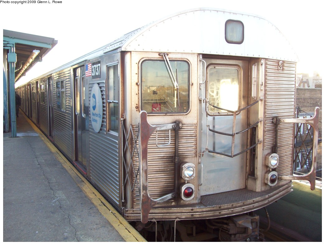 (220k, 1044x788)<br><b>Country:</b> United States<br><b>City:</b> New York<br><b>System:</b> New York City Transit<br><b>Line:</b> IND Fulton Street Line<br><b>Location:</b> Lefferts Boulevard <br><b>Route:</b> A<br><b>Car:</b> R-32 (Budd, 1964)  3737 <br><b>Photo by:</b> Glenn L. Rowe<br><b>Date:</b> 12/17/2009<br><b>Viewed (this week/total):</b> 0 / 742