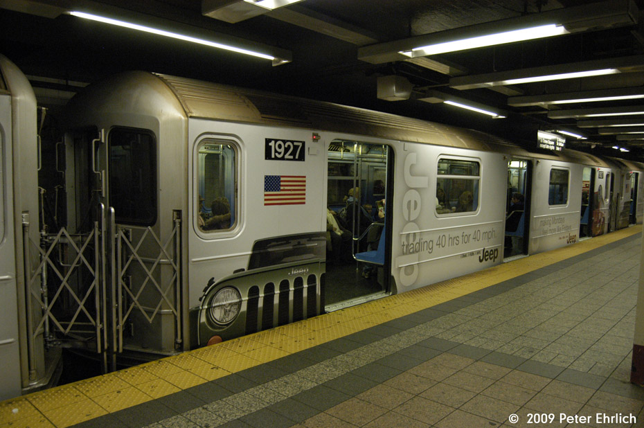 (185k, 930x618)<br><b>Country:</b> United States<br><b>City:</b> New York<br><b>System:</b> New York City Transit<br><b>Line:</b> IRT Times Square-Grand Central Shuttle<br><b>Location:</b> Grand Central <br><b>Car:</b> R-62A (Bombardier, 1984-1987)  1927 <br><b>Photo by:</b> Peter Ehrlich<br><b>Date:</b> 12/6/2009<br><b>Notes:</b> With Jeep shrinkwrap adverts.<br><b>Viewed (this week/total):</b> 3 / 925