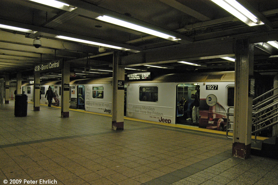 (205k, 930x618)<br><b>Country:</b> United States<br><b>City:</b> New York<br><b>System:</b> New York City Transit<br><b>Line:</b> IRT Times Square-Grand Central Shuttle<br><b>Location:</b> Grand Central <br><b>Car:</b> R-62A (Bombardier, 1984-1987)  1927 <br><b>Photo by:</b> Peter Ehrlich<br><b>Date:</b> 12/6/2009<br><b>Notes:</b> With Jeep shrinkwrap adverts.<br><b>Viewed (this week/total):</b> 0 / 940