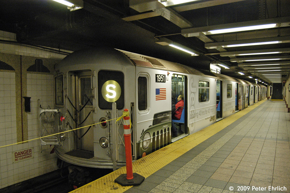 (205k, 930x618)<br><b>Country:</b> United States<br><b>City:</b> New York<br><b>System:</b> New York City Transit<br><b>Line:</b> IRT Times Square-Grand Central Shuttle<br><b>Location:</b> Grand Central <br><b>Car:</b> R-62A (Bombardier, 1984-1987)  1951 <br><b>Photo by:</b> Peter Ehrlich<br><b>Date:</b> 12/6/2009<br><b>Notes:</b> With Jeep shrinkwrap adverts.<br><b>Viewed (this week/total):</b> 1 / 1213