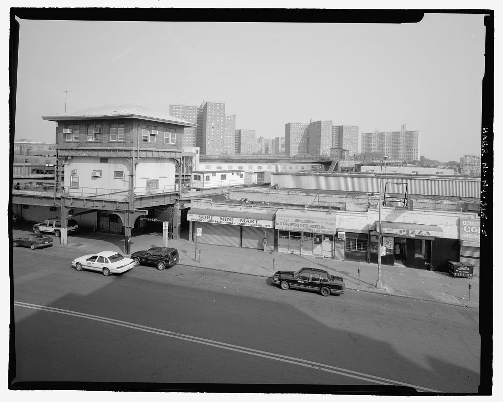 (112k, 1024x819)<br><b>Country:</b> United States<br><b>City:</b> New York<br><b>System:</b> New York City Transit<br><b>Location:</b> Coney Island/Stillwell Avenue<br><b>Photo by:</b> Rob Tucher, Historic American Engineering Record<br><b>Collection of:</b> Library of Congress, Prints and Photographs Division<br><b>Notes:</b> Elevated view across Stillwell Avenue showing control tower and storefronts. Looking east by northeast.<br><b>Viewed (this week/total):</b> 0 / 2603