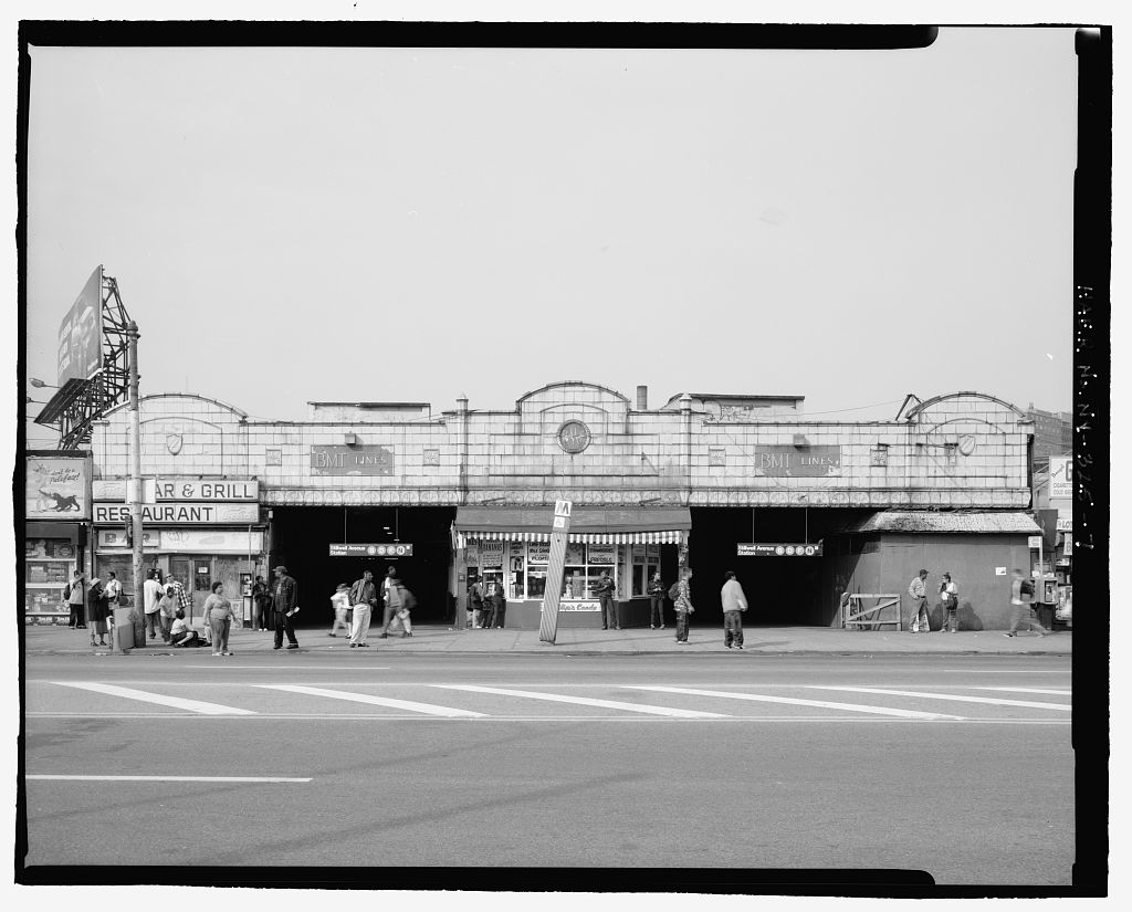 (108k, 1024x825)<br><b>Country:</b> United States<br><b>City:</b> New York<br><b>System:</b> New York City Transit<br><b>Location:</b> Coney Island/Stillwell Avenue<br><b>Photo by:</b> Rob Tucher, Historic American Engineering Record<br><b>Collection of:</b> Library of Congress, Prints and Photographs Division<br><b>Notes:</b> South facade of Stillwell Avenue station facing Surf Avenue. Looking north.<br><b>Viewed (this week/total):</b> 0 / 1667
