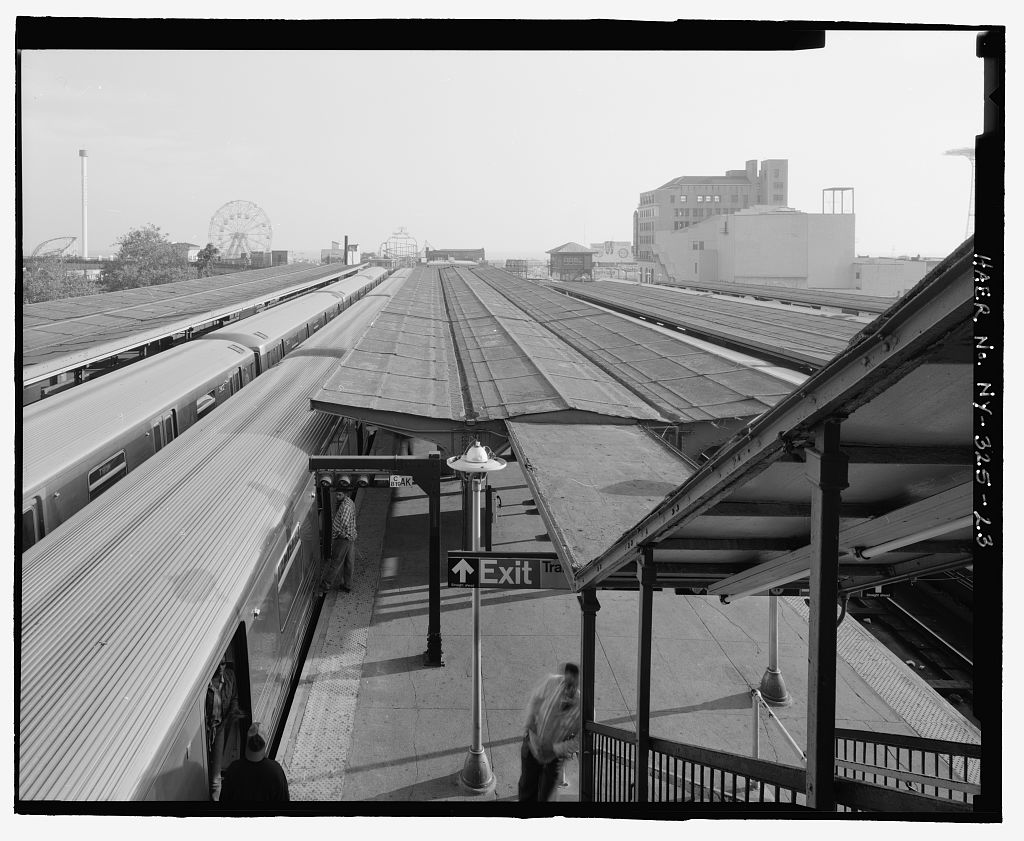 (138k, 1024x841)<br><b>Country:</b> United States<br><b>City:</b> New York<br><b>System:</b> New York City Transit<br><b>Location:</b> Coney Island/Stillwell Avenue<br><b>Photo by:</b> Rob Tucher, Historic American Engineering Record<br><b>Collection of:</b> Library of Congress, Prints and Photographs Division<br><b>Notes:</b> View toward Coney Island Amusement Park across platform canopies and trains from RTO building elevated platform. Looking south.<br><b>Viewed (this week/total):</b> 0 / 1279