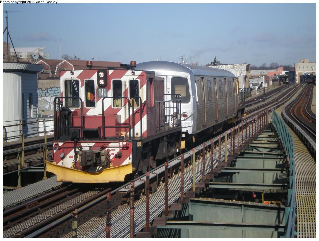(262k, 1044x788)<br><b>Country:</b> United States<br><b>City:</b> New York<br><b>System:</b> New York City Transit<br><b>Line:</b> BMT West End Line<br><b>Location:</b> 62nd Street <br><b>Route:</b> Work Service<br><b>Car:</b> R-47 (SBK) Locomotive  N1 <br><b>Photo by:</b> John Dooley<br><b>Date:</b> 12/29/2009<br><b>Viewed (this week/total):</b> 0 / 1175