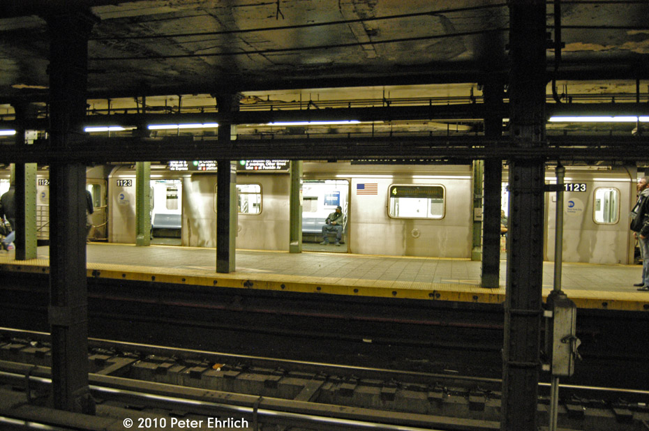 (196k, 930x618)<br><b>Country:</b> United States<br><b>City:</b> New York<br><b>System:</b> New York City Transit<br><b>Line:</b> IRT Brooklyn Line<br><b>Location:</b> Atlantic Avenue <br><b>Route:</b> 4<br><b>Car:</b> R-142 (Option Order, Bombardier, 2002-2003)  1123 <br><b>Photo by:</b> Peter Ehrlich<br><b>Date:</b> 1/6/2010<br><b>Notes:</b> Outbound to Utica Avenue.<br><b>Viewed (this week/total):</b> 1 / 1739