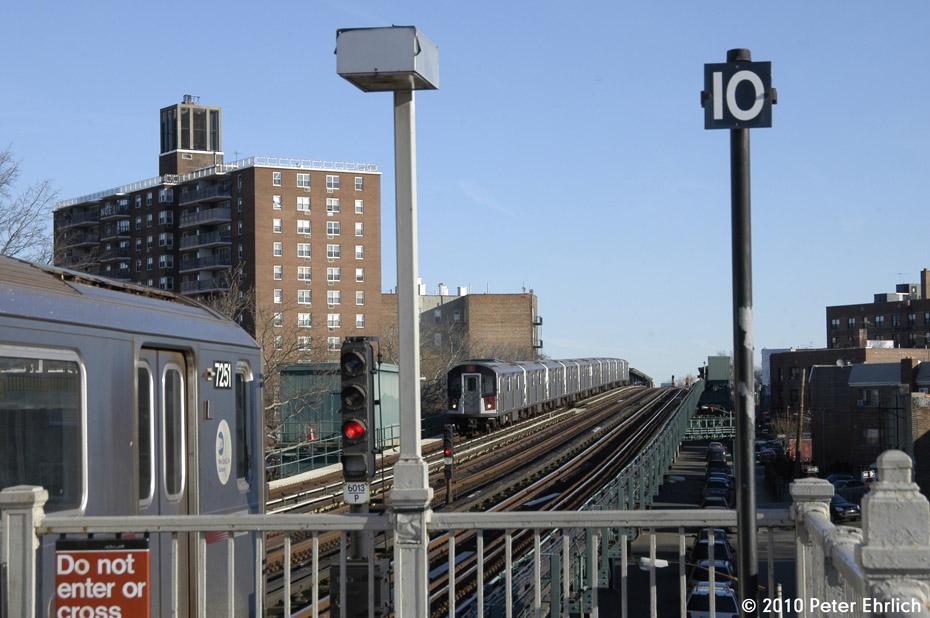 (165k, 930x618)<br><b>Country:</b> United States<br><b>City:</b> New York<br><b>System:</b> New York City Transit<br><b>Line:</b> IRT Pelham Line<br><b>Location:</b> Middletown Road <br><b>Route:</b> 6<br><b>Car:</b> R-142A (Primary Order, Kawasaki, 1999-2002)  7251 <br><b>Photo by:</b> Peter Ehrlich<br><b>Date:</b> 1/6/2010<br><b>Notes:</b> Leaving outbound.  With 7360 approaching inbound.<br><b>Viewed (this week/total):</b> 0 / 920