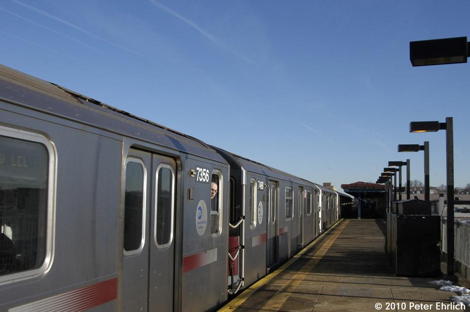 (116k, 930x618)<br><b>Country:</b> United States<br><b>City:</b> New York<br><b>System:</b> New York City Transit<br><b>Line:</b> IRT Pelham Line<br><b>Location:</b> Zerega Avenue <br><b>Route:</b> 6<br><b>Car:</b> R-142A (Primary Order, Kawasaki, 1999-2002)  7356+7466 <br><b>Photo by:</b> Peter Ehrlich<br><b>Date:</b> 1/6/2010<br><b>Notes:</b> Coupled cars arriving Zerega Avenue outbound.<br><b>Viewed (this week/total):</b> 1 / 1065