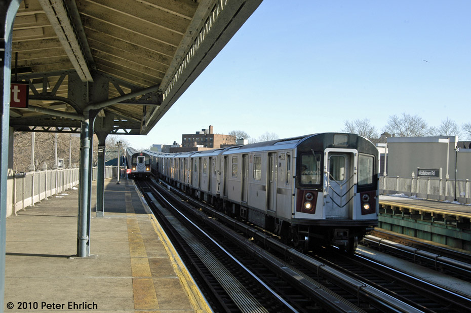 (187k, 930x618)<br><b>Country:</b> United States<br><b>City:</b> New York<br><b>System:</b> New York City Transit<br><b>Line:</b> IRT Pelham Line<br><b>Location:</b> Middletown Road <br><b>Route:</b> 6<br><b>Car:</b> R-142A (Option Order, Kawasaki, 2002-2003)  7645 <br><b>Photo by:</b> Peter Ehrlich<br><b>Date:</b> 1/6/2010<br><b>Notes:</b> Inbound; With 7560 inbound.  7645 is on the middle track, heading for Westchester Yard.<br><b>Viewed (this week/total):</b> 0 / 950