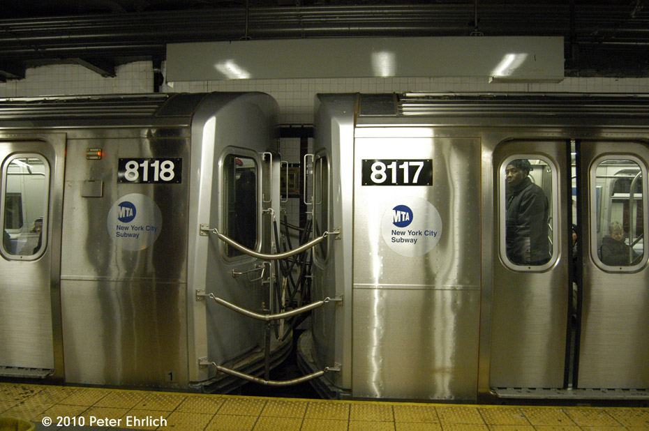 (174k, 930x618)<br><b>Country:</b> United States<br><b>City:</b> New York<br><b>System:</b> New York City Transit<br><b>Line:</b> BMT Canarsie Line<br><b>Location:</b> 8th Avenue <br><b>Route:</b> L<br><b>Car:</b> R-143 (Kawasaki, 2001-2002) 8118+8117 <br><b>Photo by:</b> Peter Ehrlich<br><b>Date:</b> 1/6/2010<br><b>Notes:</b> Coupled cars.<br><b>Viewed (this week/total):</b> 3 / 1387
