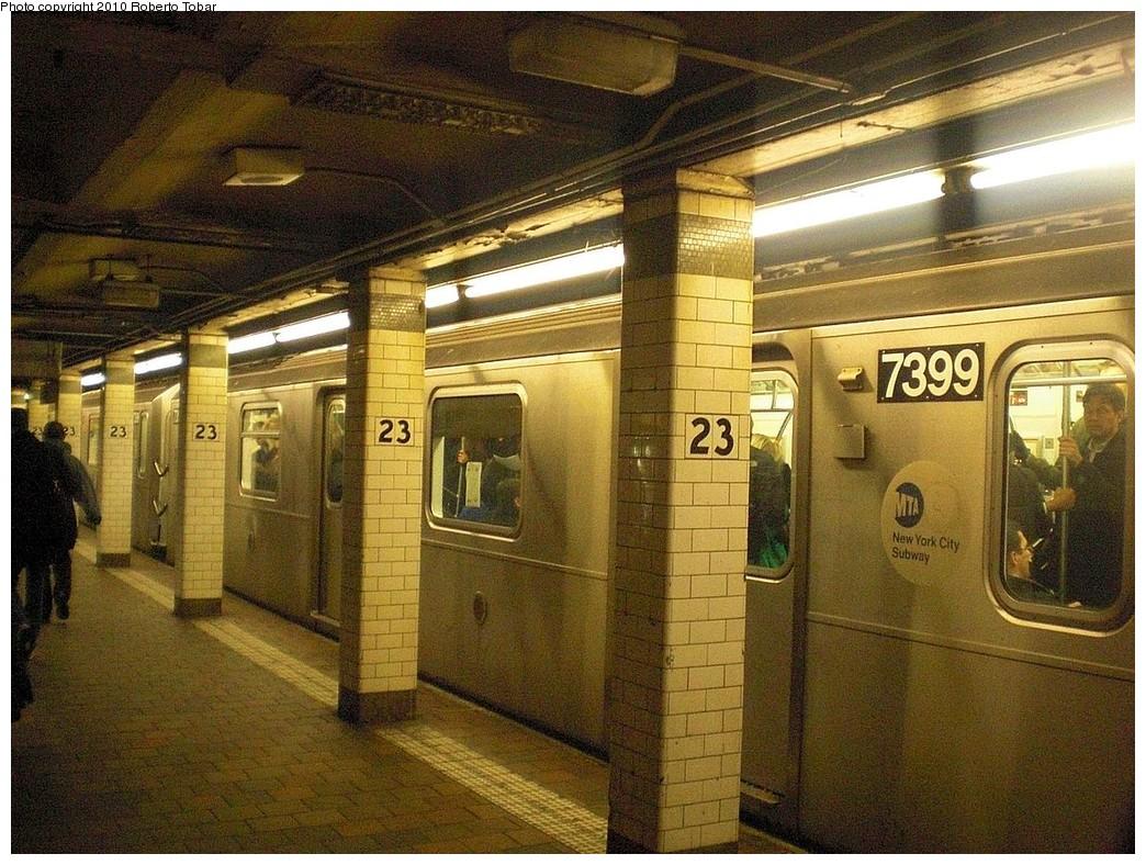 (320k, 1044x788)<br><b>Country:</b> United States<br><b>City:</b> New York<br><b>System:</b> New York City Transit<br><b>Line:</b> IRT East Side Line<br><b>Location:</b> 23rd Street <br><b>Route:</b> 6<br><b>Car:</b> R-142A (Primary Order, Kawasaki, 1999-2002)  7399 <br><b>Photo by:</b> Roberto C. Tobar<br><b>Date:</b> 2/5/2010<br><b>Viewed (this week/total):</b> 3 / 1589