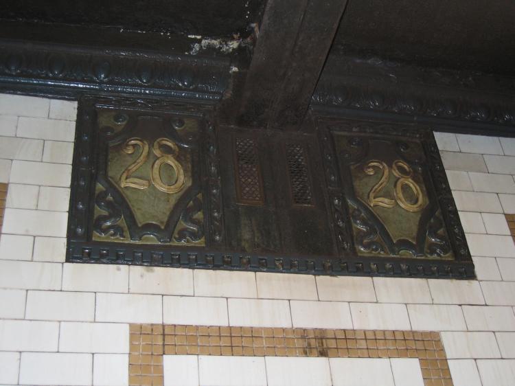 (51k, 750x562)<br><b>Country:</b> United States<br><b>City:</b> New York<br><b>System:</b> New York City Transit<br><b>Line:</b> IRT East Side Line<br><b>Location:</b> 28th Street <br><b>Photo by:</b> Robbie Rosenfeld<br><b>Date:</b> 3/2/2005<br><b>Notes:</b> Faience plaque, Heins & LaFarge/Grueby Faience Company, 1904. Original design element, Contract 1 IRT.<br><b>Viewed (this week/total):</b> 0 / 2373