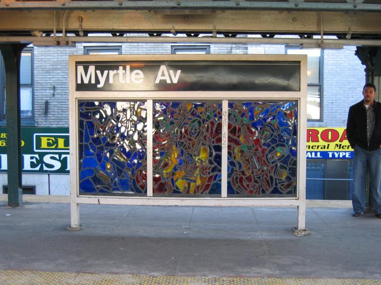 (87k, 750x562)<br><b>Country:</b> United States<br><b>City:</b> New York<br><b>System:</b> New York City Transit<br><b>Line:</b> BMT Nassau Street/Jamaica Line<br><b>Location:</b> Myrtle Avenue <br><b>Photo by:</b> Robbie Rosenfeld<br><b>Date:</b> 3/14/2005<br><b>Artwork:</b> <i>Jammin' Under the El</i>, Verna Hart (1999).<br><b>Viewed (this week/total):</b> 1 / 2254