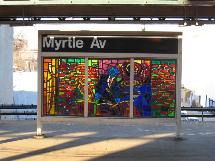 (81k, 750x562)<br><b>Country:</b> United States<br><b>City:</b> New York<br><b>System:</b> New York City Transit<br><b>Line:</b> BMT Nassau Street-Jamaica Line<br><b>Location:</b> Myrtle Avenue<br><b>Photo by:</b> Robbie Rosenfeld<br><b>Date:</b> 3/14/2005<br><b>Artwork:</b> <i>Jammin' Under the El</i>, Verna Hart, 1999<br><b>Viewed (this week/total):</b> 0 / 3028