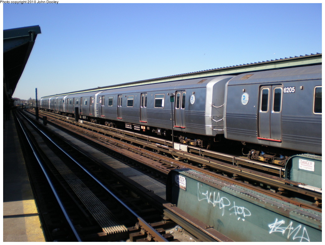 (214k, 1044x788)<br><b>Country:</b> United States<br><b>City:</b> New York<br><b>System:</b> New York City Transit<br><b>Line:</b> IND Fulton Street Line<br><b>Location:</b> Rockaway Boulevard <br><b>Route:</b> A<br><b>Car:</b> R-46 (Pullman-Standard, 1974-75) 6203 <br><b>Photo by:</b> John Dooley<br><b>Date:</b> 3/6/2010<br><b>Viewed (this week/total):</b> 0 / 623