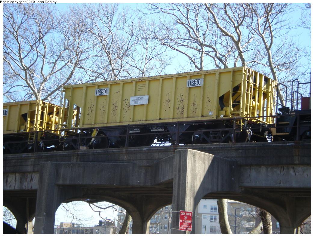 (341k, 1044x788)<br><b>Country:</b> United States<br><b>City:</b> New York<br><b>System:</b> New York City Transit<br><b>Line:</b> IND Rockaway<br><b>Location:</b> Beach 90th Street/Holland <br><b>Route:</b> Work Service<br><b>Car:</b> R-80 MoW Hopper (1983, Maxon)  280 <br><b>Photo by:</b> John Dooley<br><b>Date:</b> 3/6/2010<br><b>Viewed (this week/total):</b> 1 / 772