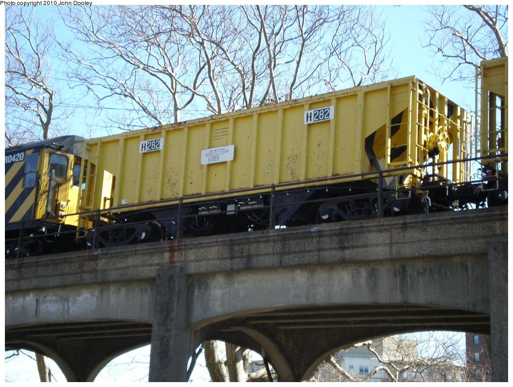 (296k, 1044x788)<br><b>Country:</b> United States<br><b>City:</b> New York<br><b>System:</b> New York City Transit<br><b>Line:</b> IND Rockaway<br><b>Location:</b> Beach 90th Street/Holland <br><b>Route:</b> Work Service<br><b>Car:</b> R-80 MoW Hopper (1983, Maxon)  282 <br><b>Photo by:</b> John Dooley<br><b>Date:</b> 3/6/2010<br><b>Viewed (this week/total):</b> 2 / 815